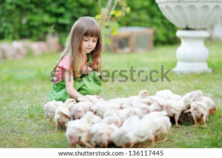 portrait of a little girl and chickens - stock photo