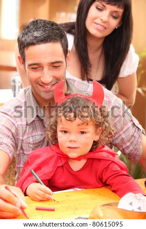 portrait of a little girl and parents - stock photo