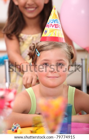 portrait of a little girl at birthday party - stock photo
