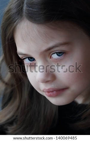 Portrait of a little girl crying. - stock photo
