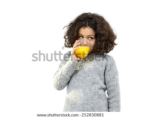 Portrait of a little girl drinking orange juice isolated on white - stock photo