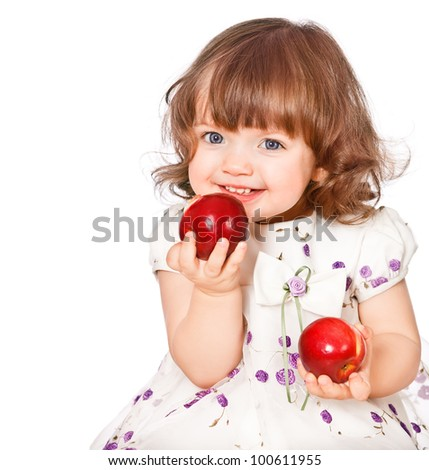 portrait of a little girl eating apples - stock photo
