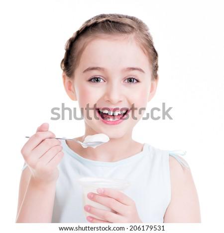Portrait of a  little girl eating yogurt - isolated on white. - stock photo