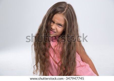 Portrait of a little girl fooling around isolated on a white background - stock photo