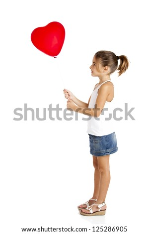 Portrait of a little girl holding and looking to a red balloon, isolated on white background - stock photo