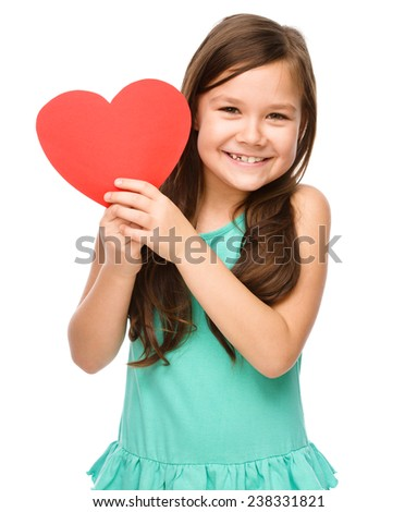 Portrait of a little girl holding red heart, isolated over white - stock photo