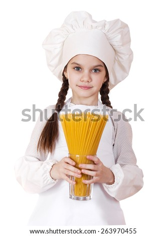 Portrait of a little girl in a white apron holding a glass of spaghetti, isolated on white background - stock photo