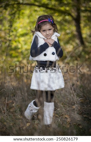Portrait of a little girl in park - stock photo