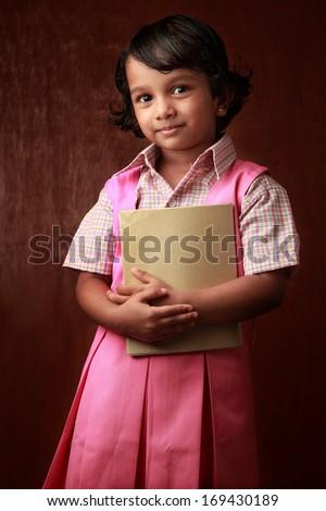 Portrait of a little girl in school uniform  - stock photo