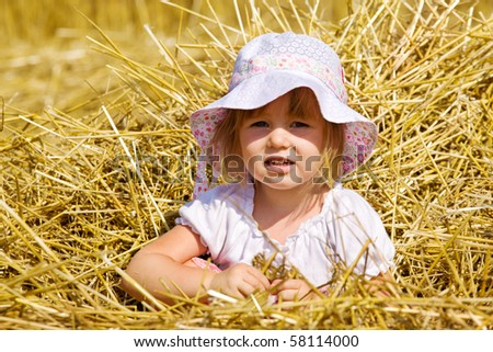 Portrait of a little girl in straw - stock photo