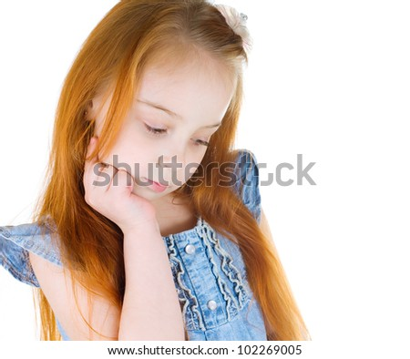 Portrait of a  little girl looking down - stock photo