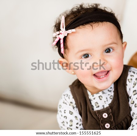 Portrait of a little girl looking very happy