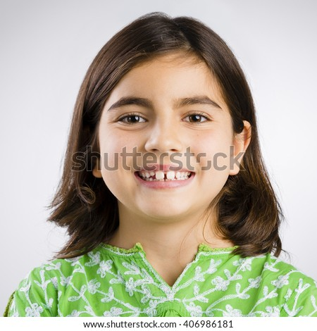 Portrait of a little girl making a happy expression - stock photo