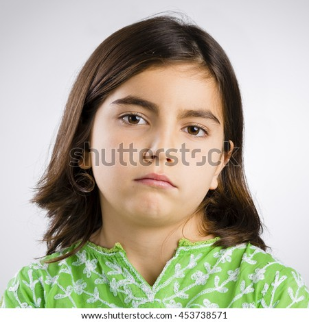 Portrait of a little girl making a serious expression - stock photo
