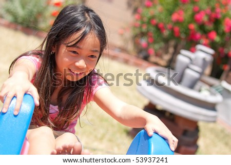 Portrait of a Little Girl Playing - stock photo