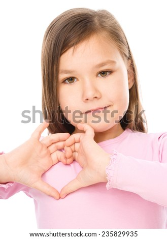 Portrait of a little girl showing heart gesture, isolated over white - stock photo