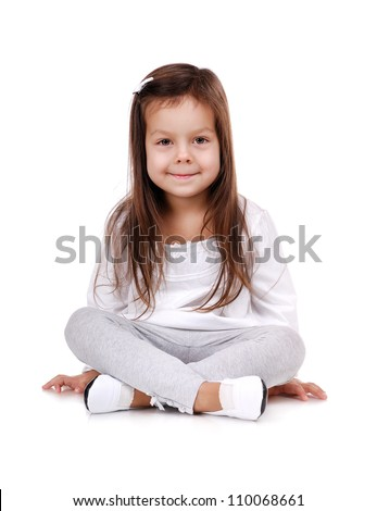Portrait of a little girl sitting on the floor on white background - stock photo