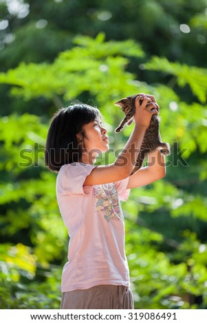 portrait of a little girl with a cat - stock photo