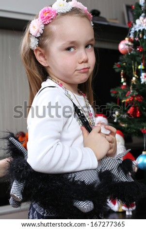 portrait of a little girl with a handbag over her shoulder - stock photo