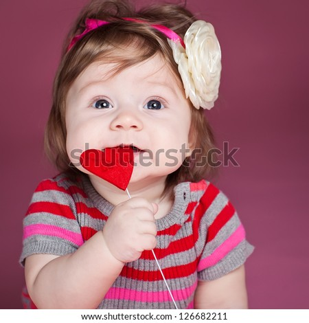 Portrait of a little girl with a heart - stock photo