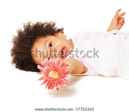 Portrait of a little girl with a pink flower on white background - stock photo