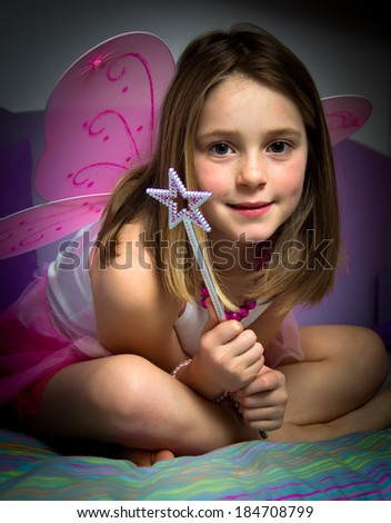 Portrait of a little girl with butterfly wings - stock photo