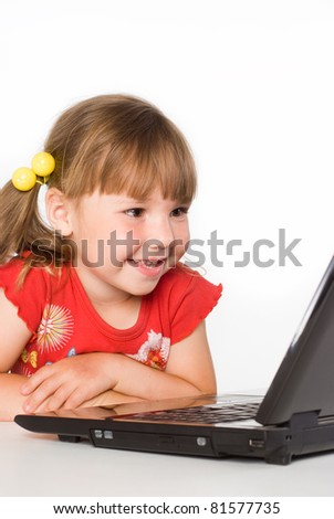 portrait of a little girl with computer
