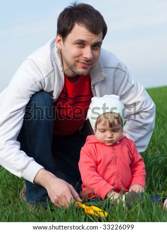 Portrait of a little girl with father outdoors - stock photo