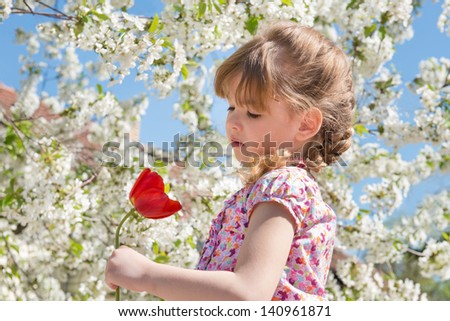 portrait of a little girl with flowers