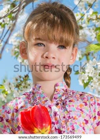 portrait of a little girl with flowers - stock photo