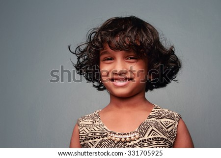 Portrait of a little girl with uncombed loose hair - stock photo
