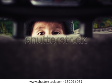 Portrait of a little kid in the car - stock photo