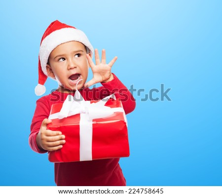portrait of a little kid on a christmas morning waiting for open his gifts - stock photo