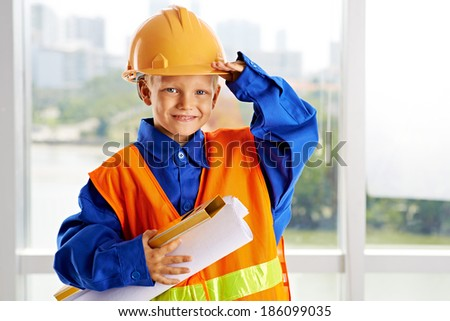 Portrait of a little man dressed as a construction worker - stock photo
