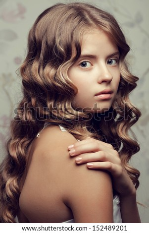 with pearls posing over vintage background. Girl with perfect glossy ...
