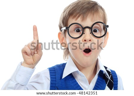 Portrait of a little smiling boy in a funny glasses. Isolated over white background. - stock photo