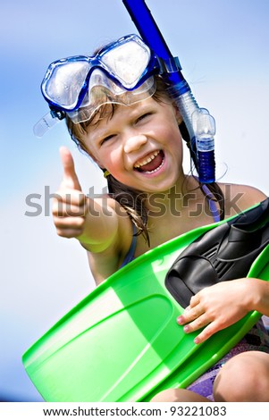 portrait of a little snorkeling girl with flippers - stock photo