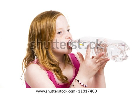 Portrait of a little young girl drinking water - stock photo