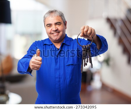 portrait of a locksmith holding an old keys bunch - stock photo