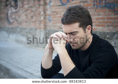 portrait of a lonely man in a street - stock photo