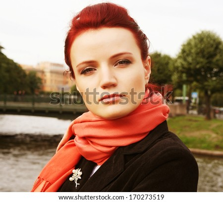 portrait of a lonely young  woman outdoor on the bridge  - stock photo