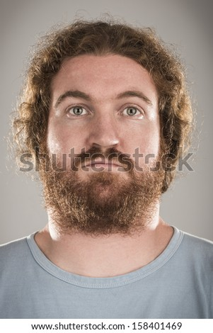 Portrait of a long red haired and bearded  caucasian young man - stock photo