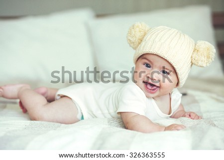 Portrait of a lovable 5 months baby lying down on a blanket - stock photo