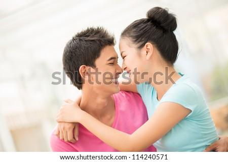 Portrait of a lovely couple enjoying the moments of love and happiness - stock photo