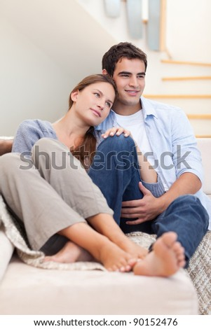 Portrait of a lovely couple in their living room - stock photo