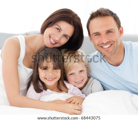 Portrait of a lovely family - stock photo