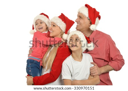 Portrait of a lovely family wearing Christmas holiday caps