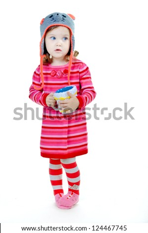 Portrait of a lovely little girl in knitted handmade hat - stock photo