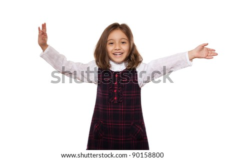 portrait of a lovely little girl, smiling, dressed in school uniform, isolated on white background