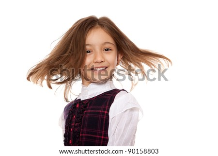 portrait of a lovely little girl, smiling, dressed in school uniform, isolated on white background - stock photo